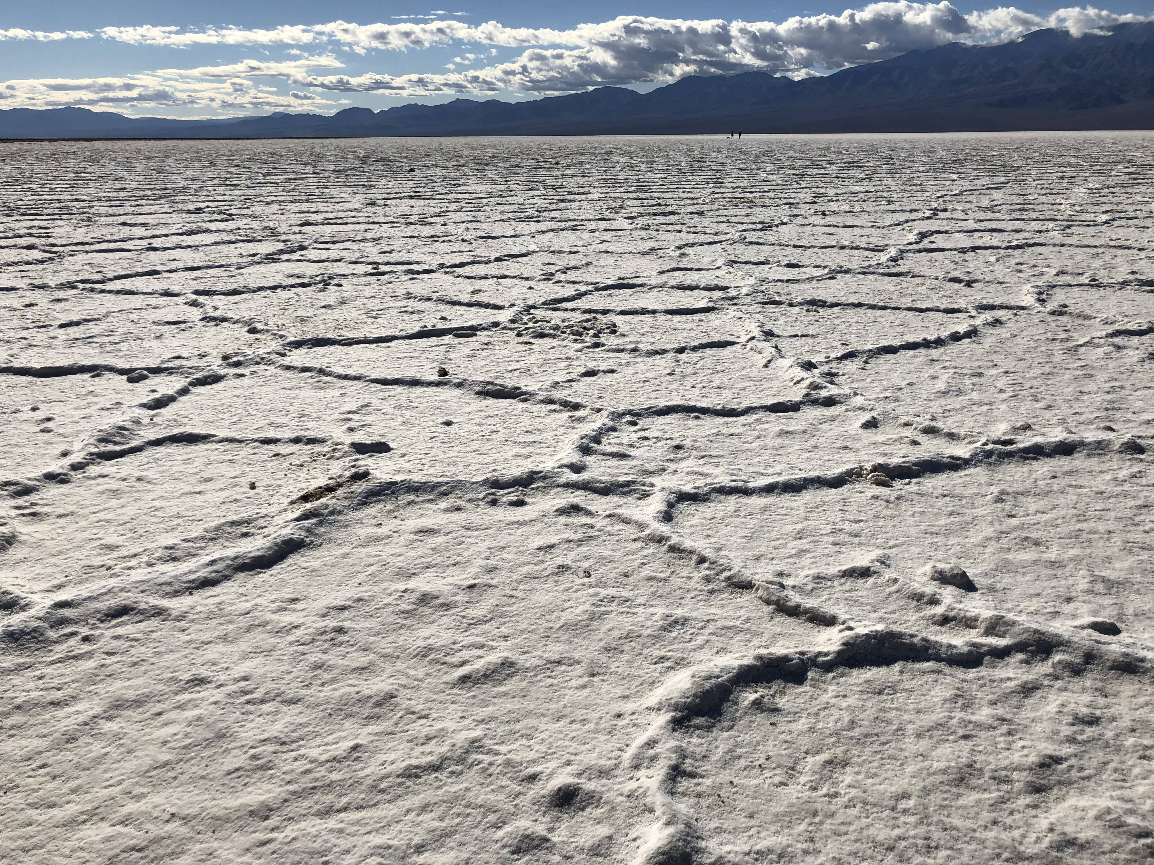 The vast surreal salt flats of Badwater Basin change constantly. Salt crystals expand, pushing the crust of salt into rough, chaotic forms.
